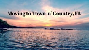 """Sunset view of Tampa Bay with text overlay, """"Moving to Town 'n' Country, FL""""."""