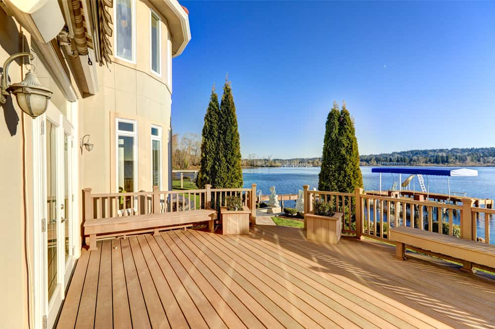 Deck of a waterfront home on a sunny day.