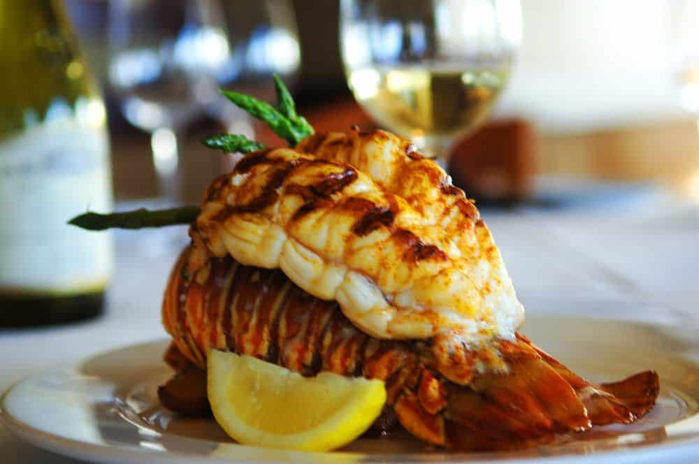 Grilled lobster tail with lemon.