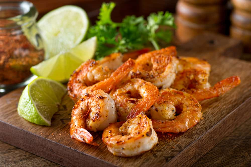 Plate of shrimp with lime and cilantro